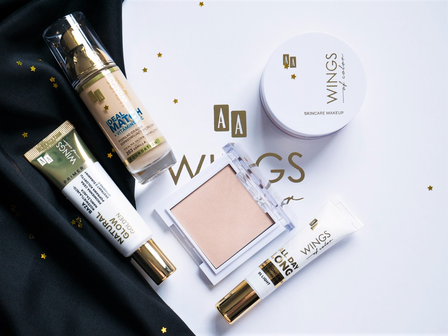 AA Wings of Color | 5 kosmetyków wartych wypróbowania Baza rozświetlająco - nawilżająca Natural Glow Golden, podkład Ideal Match, korektor All Day Long Multi Concealer, puder 100% Mineral Loose Powder, Efektowny rozświetlacz do modelowania Precious White Gold